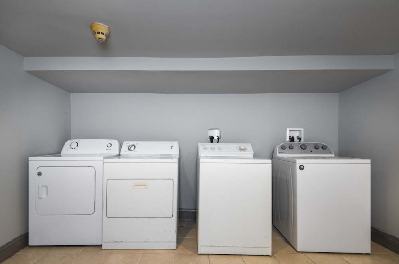 Laundry room with washer and dryer on site at 1316 Pine Street