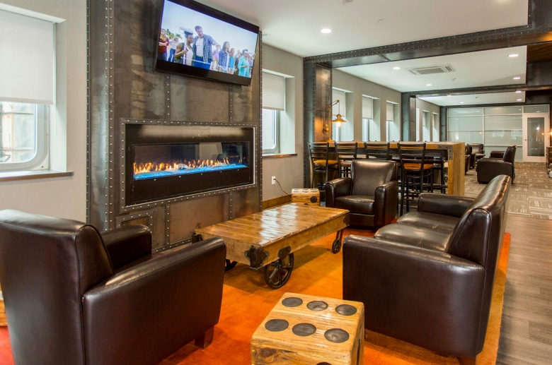 Resident lounge with gas fireplace and flatscreen TV