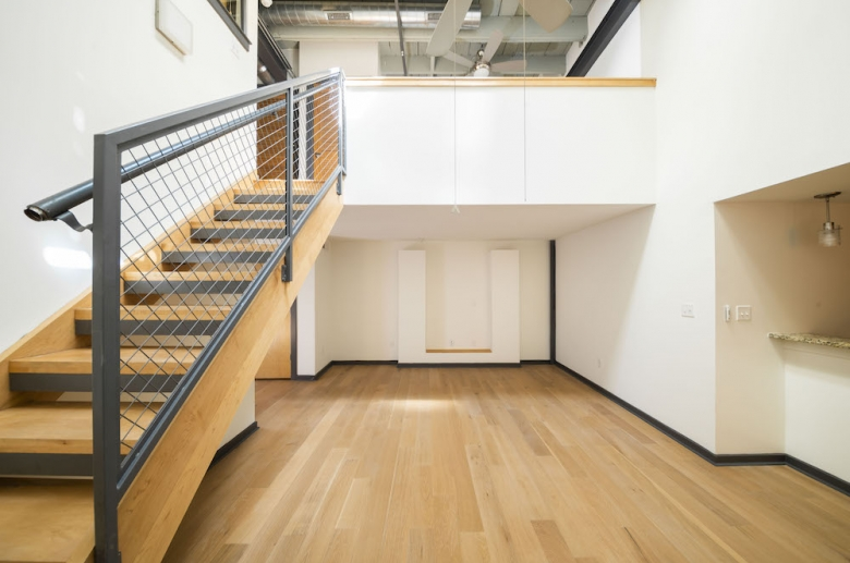 Living space with modern open staircase