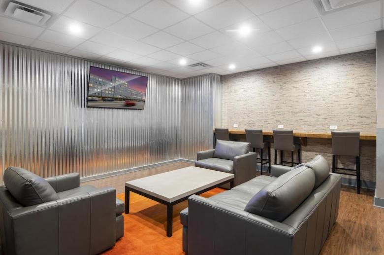 Furnished lounge with flatscreen TV