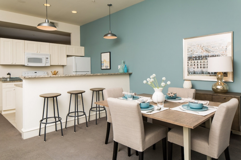 Modern kitchens with granite countertops, and breakfast bar.