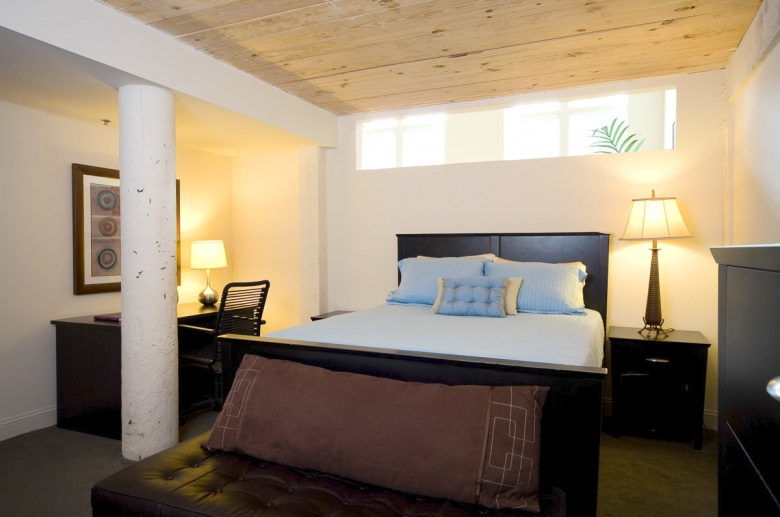Original columns and wooden beam ceilings on Granby Mills beedrooms