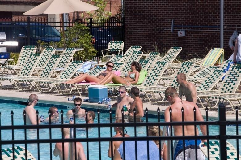 Sunbathing area surrounding the pool