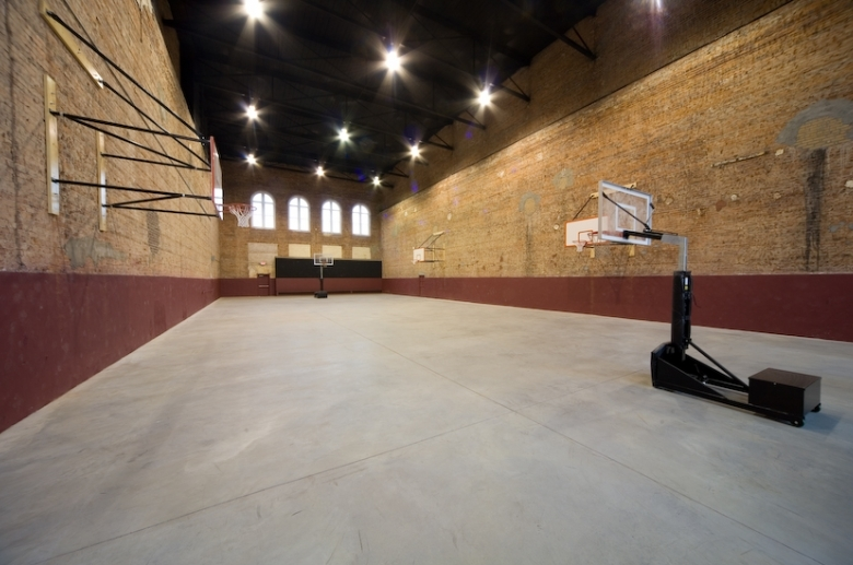 In-door basketball court with multiple sized baskets