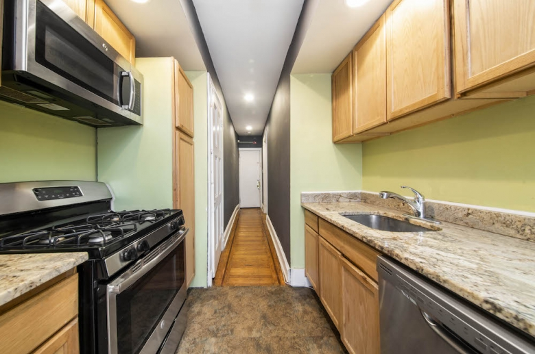 Galley kitchen with gas stove
