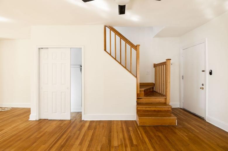 Common areas featuring gleaming hardwood floors