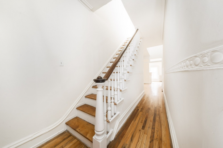 Hardwood flooring extends throughout a staircase on bi-level units