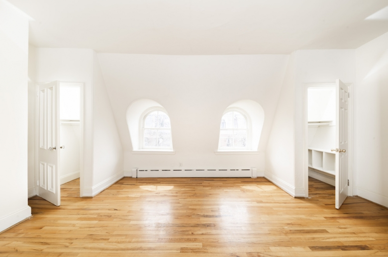 Bedrooms with hardwood flooring and curved dormer windows