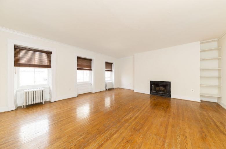 Living space with fireplace and built-in shelving