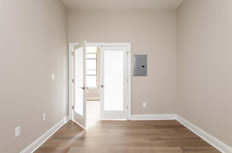 Waterfront Apartments' hardwood rooms