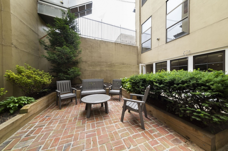 Outdoor common space with table and seating