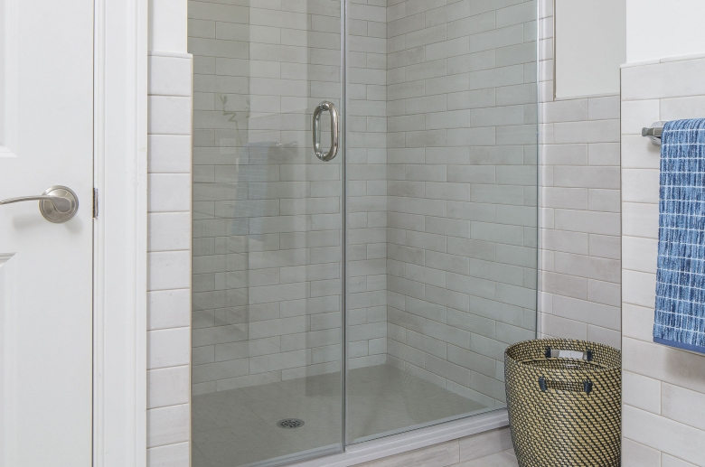 Residence on the Green shower featuring glass door