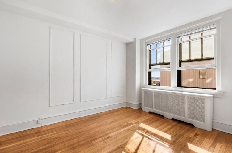 Bright sunny bedroom with hardwood flooring