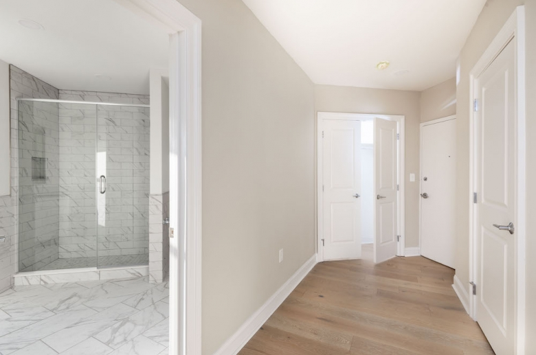 Hallway and adjacent upgraded bathroom