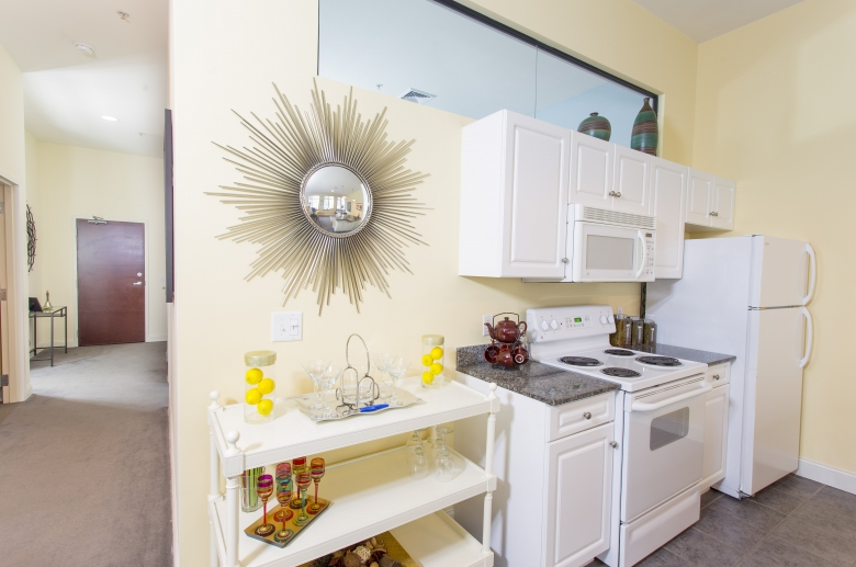 Modern kitchen featuring granite countertops and white cabinets