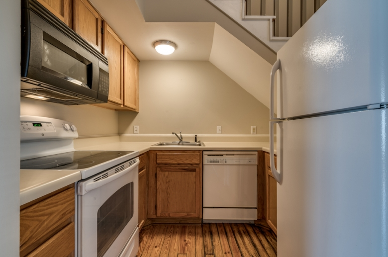 Kitchen featuring wooden cabinets