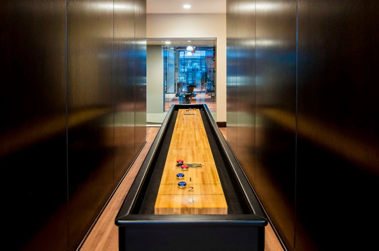 Resident lounge featuring table games, such as shuffleboard
