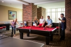 Lounge with pool table at 612 Whaley