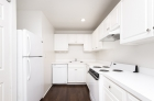 Modern kitchen featuring white appliances