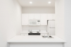 Fully-equipped kitchen with dishwasher and breakfast bar