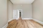 Bedroom with beautiful hardwood flooring