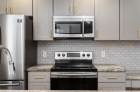 Waterfront Apartments' kitchen featuring granite countertops and stainless steel appliances