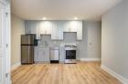 Open concept kitchen with hardwood flooring