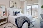 Bedroom features floor-to-ceiling windows