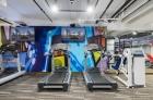 Flatscreen TV and radio at 915 Main Street fitness center