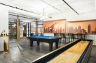 915 Main Street lounge includes billiards and shuffleboard.