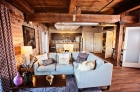 Cabin-styled living and kitchen at Palmetto Compress