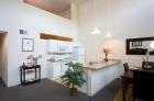 Granby Mills open-concept kitchen featuring granite countertops