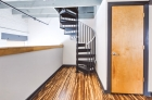 Spiral staircase in bi-level unit