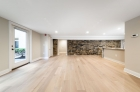 Waterfront Apartments' Old World charm living featuring exposed brick walls