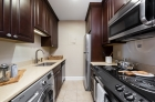 Galley kitchen with top-tier amenities