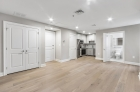 Hardwood flooring and recessed lighting in common spaces