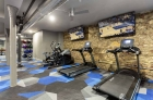 Modern cardio machines and televisions on the fitness center