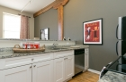 Kitchens feature granite countertops, stainless steel appliances, and beautiful hardwood floors