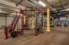 Strength training equipment at The Cottages inside the fitness center